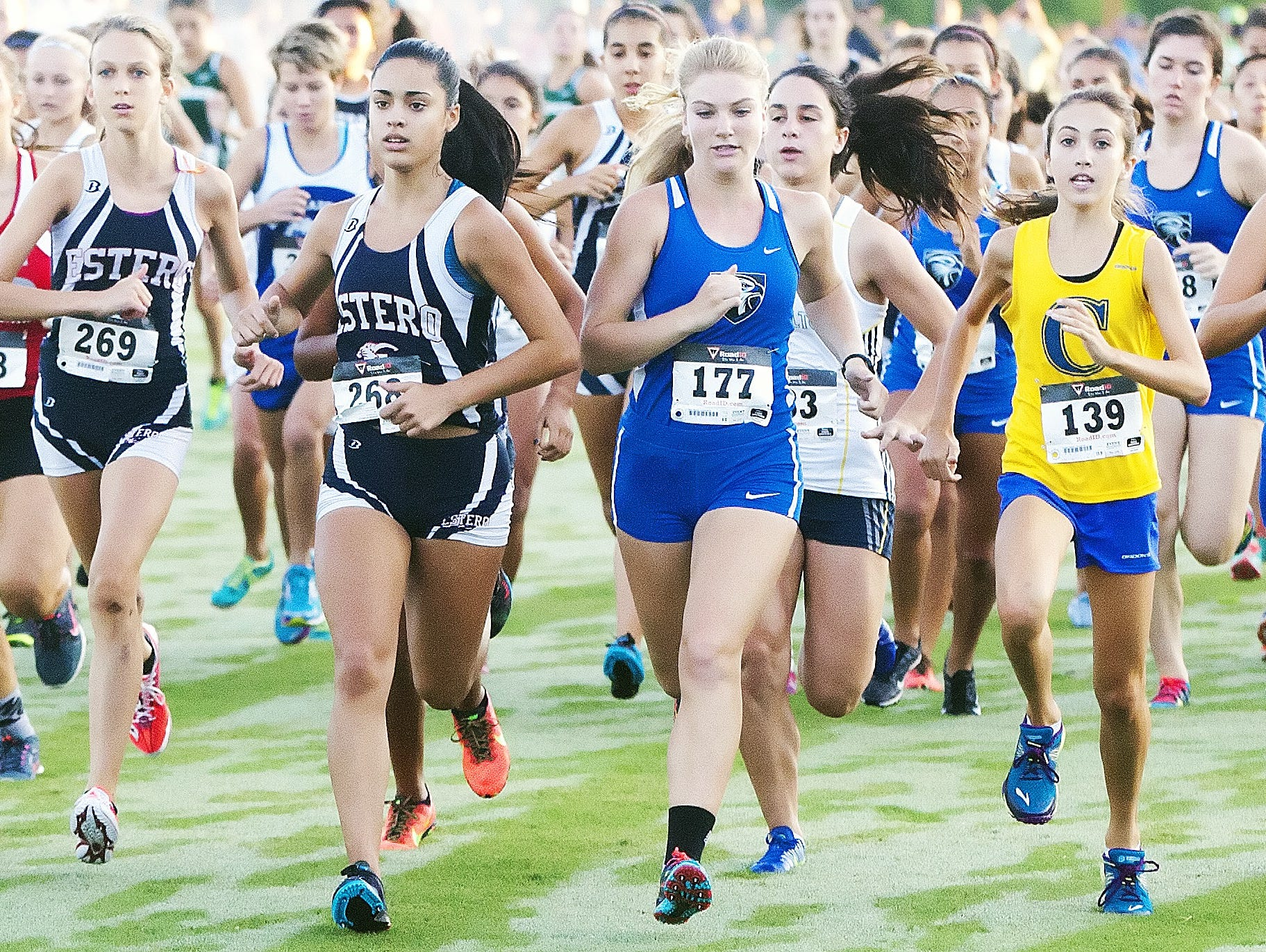 Estero's Megan Giovanniello, left center, is one of a handful of runners expected to contend for top finishes at region races on Friday and Saturday.