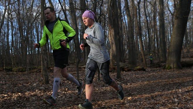 Nicole Fargnoli-Minster runs with the Fleet Feet Endurance Team at Cobbs Hill park in preparation for running a trail marathon.