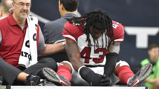 Arizona Cardinals DB Mike Jenkins (43) is taken off the field by cart after an injury during the first half of an NFL preseason football game against the Houston Texans, Sunday, Aug. 28, 2016, in Houston.
