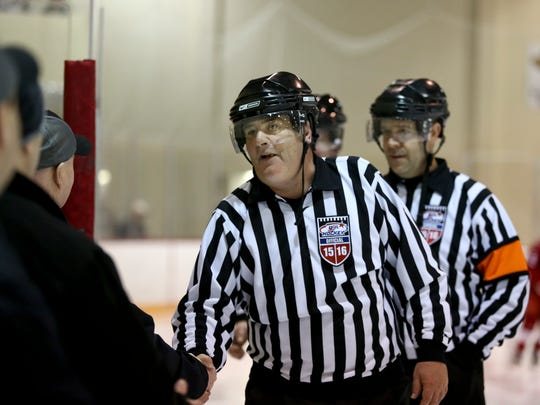 Scott Farquhar shakes hands with Brantford 99ers coaches before a Silver Stick hockey game Saturday, Jan. 9, 2016 at McMorran Pavilion. Farquhar is calling it quits after 36 years of officiating.