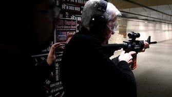 Columnist Mike Kelly prepares to fire an AR-15-style rifle at the Gun For Hire range in Woodland Park.