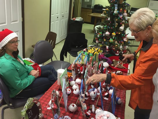 Visitors to the Arts & Crafts Show browse for Christmas