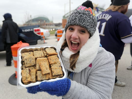 Jessie Merz of West Allis displays her chocolate chip bacon brownies before the 2016 Milwaukee Brewers home opener. Chilly weather never holds a good tailgater down.