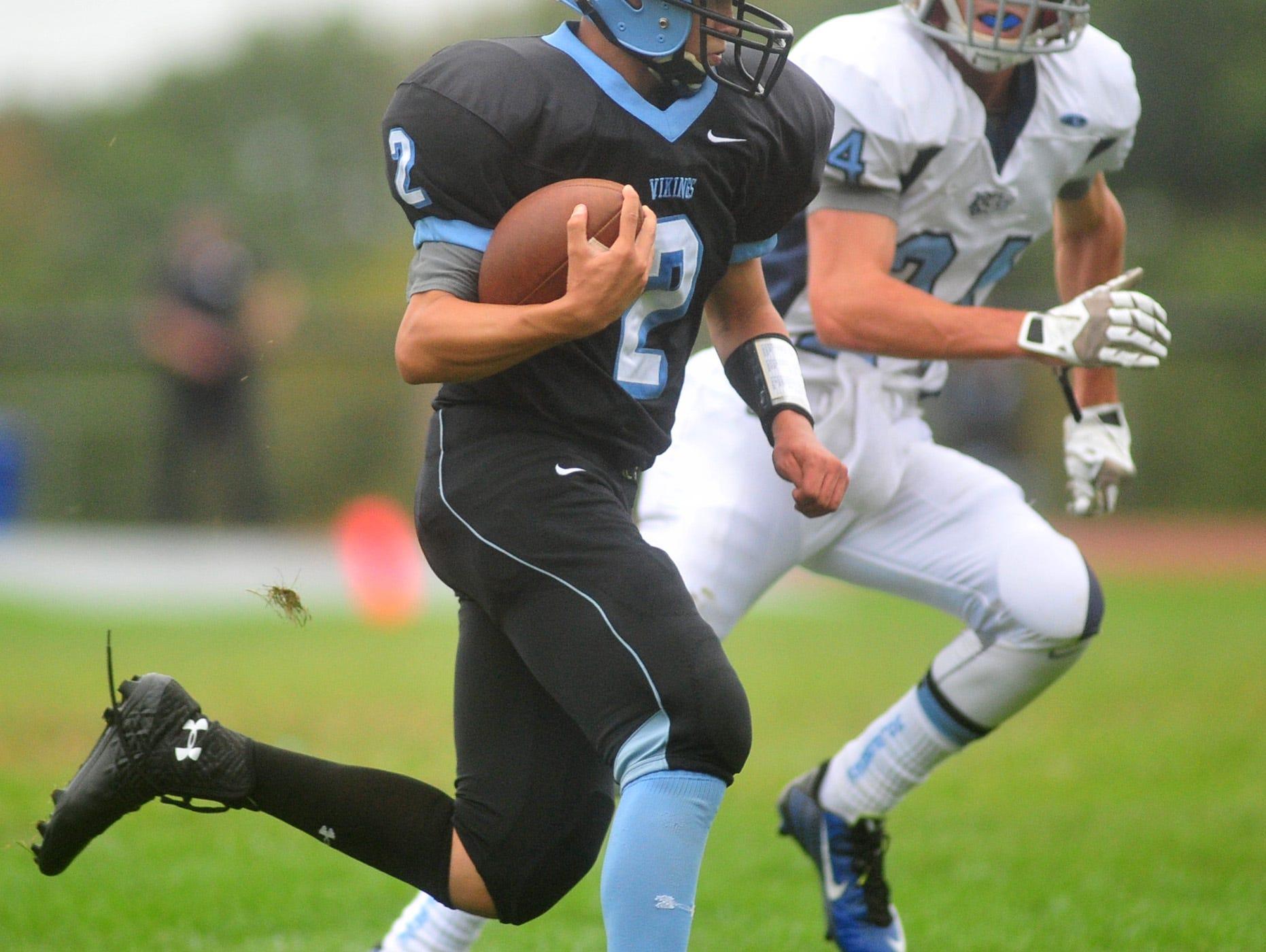 Parsippany Hills quarterback Nick Verducci carries the ball last September.