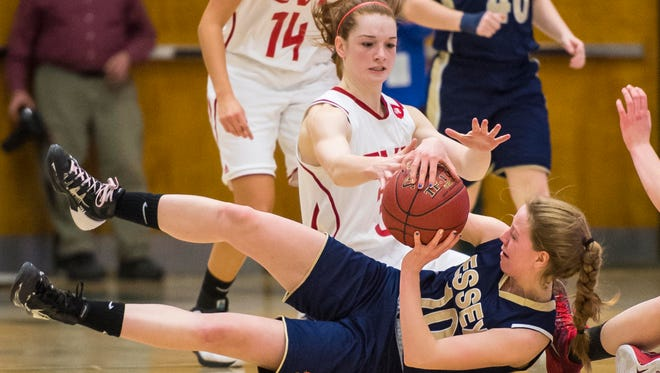 Champlain Valley's Sadie Otley, rear, and Essex's Emily Goodrich go after the ball during the Division I girls basketball state championship at Patrick Gymnasium on Tuesday night.