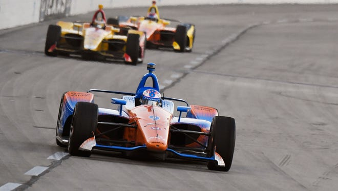 Scott Dixon, of New Zealand, heads into Turn 1 during the IndyCar auto race Saturday, June 9, 2018, in Fort Worth, Texas. Dixon won the race. (AP Photo/Larry Papke)