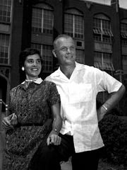 John and Annie Glenn, sweethearts since childhood, pose outside New Concord High School in this September 1957 file photo. Both attended the school before entering Muskingum College.