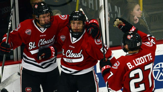St. Cloud State defenseman Mika Ilvonen, 55, celebrates with teammates after scoring  in the first period Friday against Western Michigan.