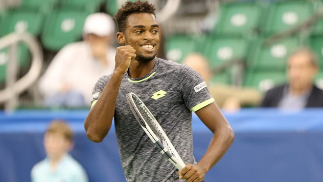 Darian King reacts as he scores a point against Bernard Tomic during their match at the Memphis Open.