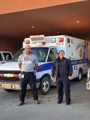 Quincy Firefighter/EMT Tom Merkle, left, returned recently from a mobilization with Team Rubicon to the Navajo Nation in the fight against COVID-19.