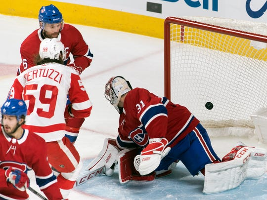 Montreal Canadiens goaltender Carey Price is scored on by Detroit Red Wings' Tyler Bertuzzi (59) as Canadiens' Shea Weber defends during the first period of an NHL hockey game, Saturday, Dec. 14, 2019, in Montreal. (Graham Hughes/The Canadian Press via AP)