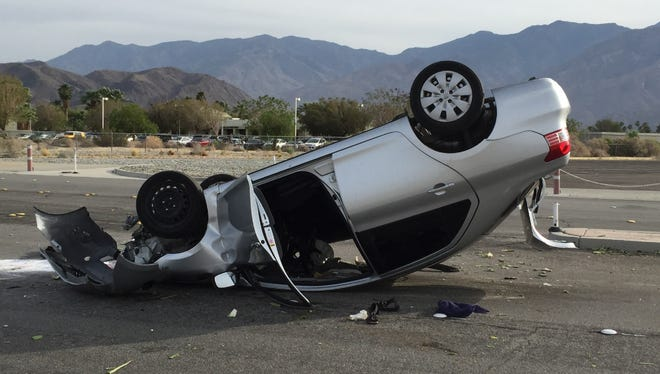 No injuries were reported after a car overturned near the Palm Springs International Airport on May 13, 2015.