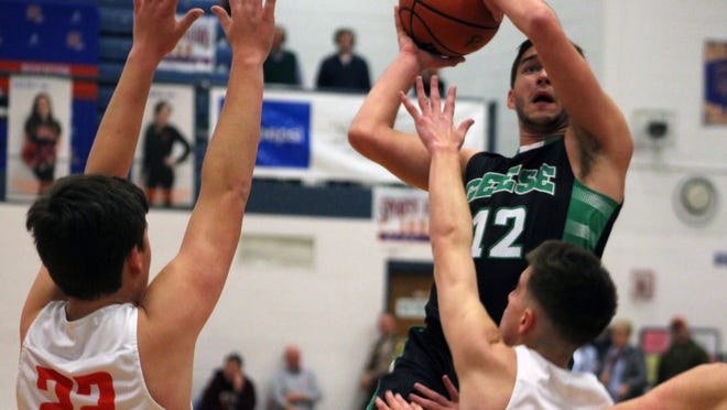 Wethersfield's Kale Nelson goes up for a shot on Saturday against New Berlin defenders.