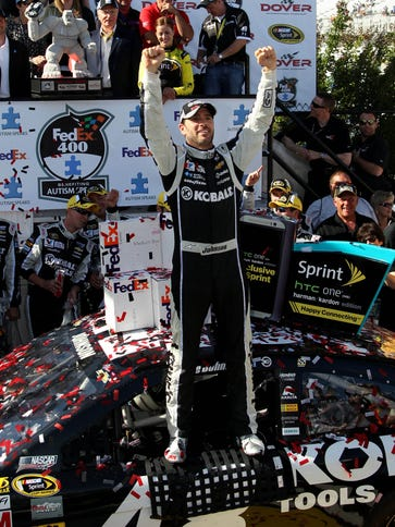 Jimmie Johnson celebrates after winning the 2014 FedEx