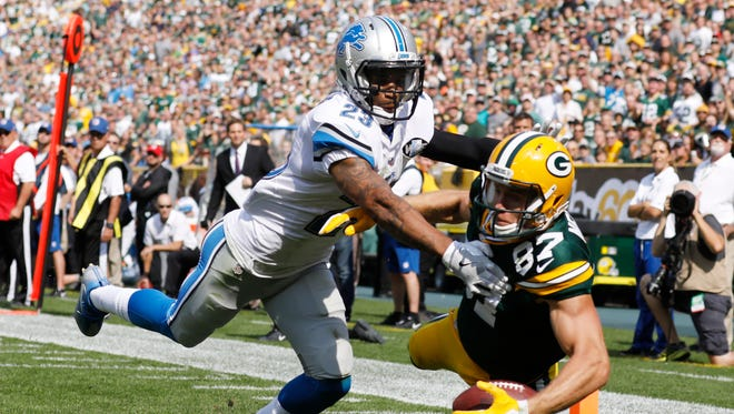 Darius Slay breaks up a pass intended for Packers receiver Jordy Nelson during the first half Sept. 25, 2016, in Green Bay, Wis.