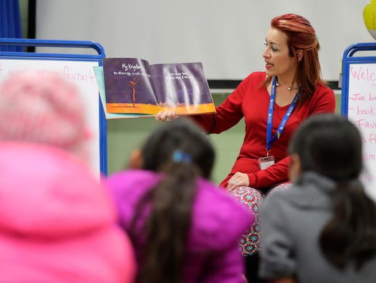Norma Oliveras, a Hispanic outreach specialist, reads