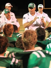 Wall High School football coach Houston Guy talks to his team after a game in 2014. The Hawks are a remarkable 84-13 under Guy since 2010.