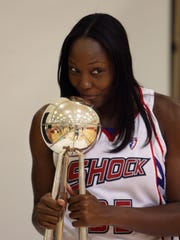The Detroit Shock won three WNBA championships in the 2000s. Here's Cheryl Ford with the trophy in 2009.