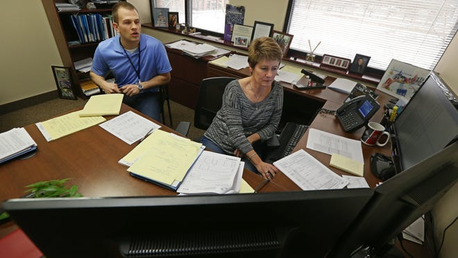 Leah Powell, partner, right, meets with Alex Proper, assistant tax accountant, in her office at the Bonadio Group in Pittsford Friday, Feb. 10, 2017.