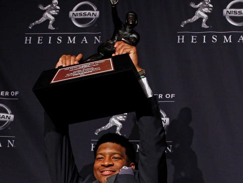 Florida State QB Jameis Winston poses for a photo after being awarded the 2013 Heisman Trophy at the Marriott Marquis in New York City.