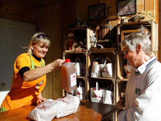 Cathy Dorow of Williamston purchases a half-gallon