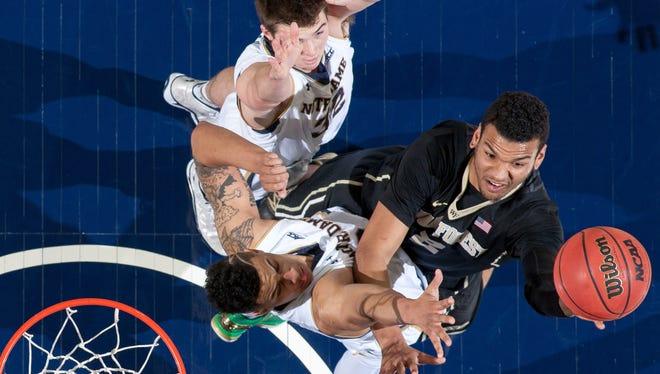 Feb 17, 2015; South Bend, IN, USA; Wake Forest Demon Deacons forward Devin Thomas (2) goes up for a shot as Notre Dame Fighting Irish guard Steve Vasturia (32) and forward Zach Auguste (30) defend in the first half at the Purcell Pavilion. Notre Dame won 88-75. Mandatory Credit: Matt Cashore-USA TODAY Sports