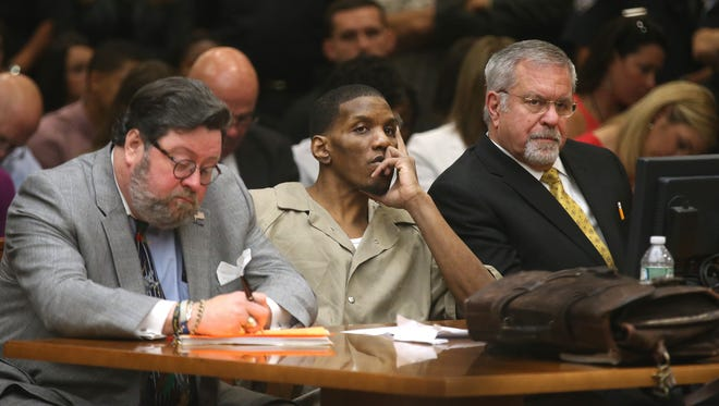 Thomas Johnson lll, with his lawyers, in the courtroom for his sentencing.