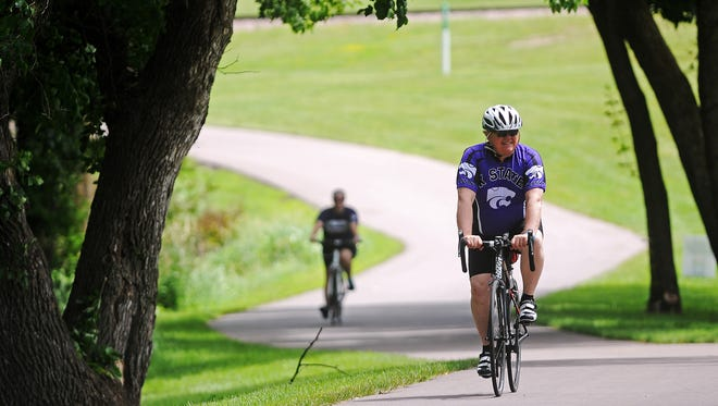 Randy Clark, of Sioux Falls, rides through Pasley Park on the bike path during Tour Sioux Falls on Saturday.