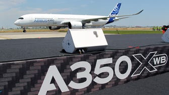 The Airbus A350 lands after its maiden flight at Blagnac airport near Toulouse, France, on June 14, 2013.