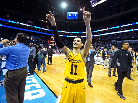 UMBC Retrievers guard K.J. Maura (11) waves to fans