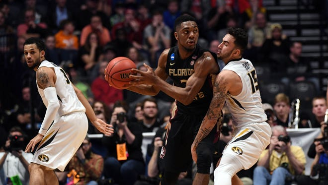 Florida State Seminoles guard Trent Forrest (3) controls the ball against Missouri Tigers guard Jordan Geist (15) during the first half in the first round of the 2018 NCAA Tournament at Bridgestone Arena. Mandatory Credit: Christopher Hanewinckel-USA TODAY Sports