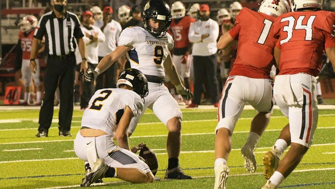 Corbin Poston (9) makes a kick during Friday's non-district football loss at Melissa. Poston is third on the team in scoring, with 29 points, including a 38-yard field goal that gave the Yellow Jackets a 31-29 halftime lead over Melissa.