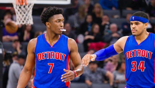 Pistons forward Stanley Johnson (7) and forward Tobias Harris.