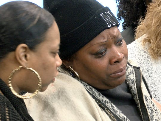 Salah Ali's wife Donna (center) is shown before the