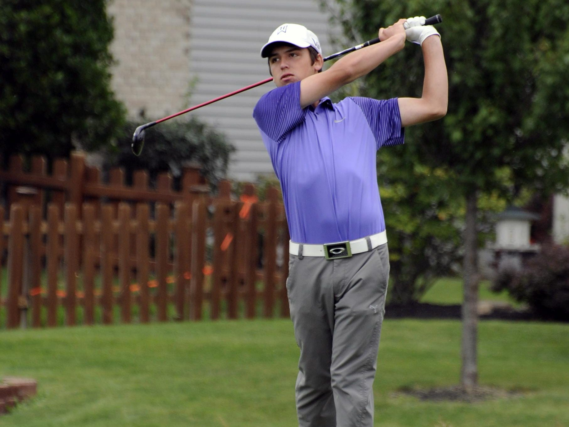 Bloom-Carroll's Bryce Walters tees off on the eighth hole during a 2014 tournament at Westchester Golf Course in Canal Winchester.