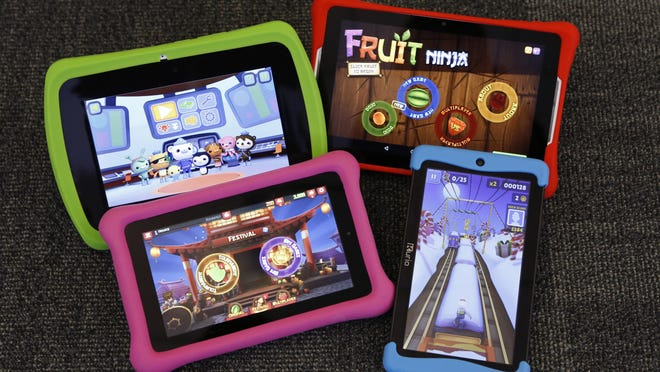 Clockwise, from upper left, are LeapFrog's Epic, a Nabi Elev-8, Kurio's Xtreme 2 and an Amazon Fire Kids Edition.