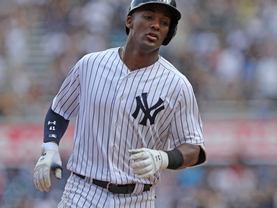 Miguel Andujar rounds the bases after hitting a solo home run in the 5th inning.
