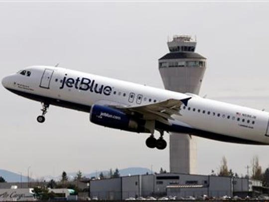 Jet Blue plane takes off in front of Seattle-Tacoma International Airport.