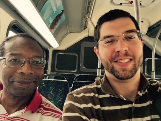D&C reporter Justin Murphy and fellow bus passenger Ronald Sampson of Webster.