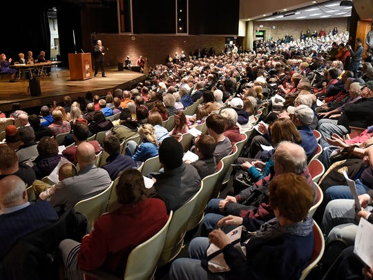 Tom Emmer speaks in a standing-room-only auditorium Tuesday during the Senate District 14 Republican Caucus at Apollo High School in St. Cloud.