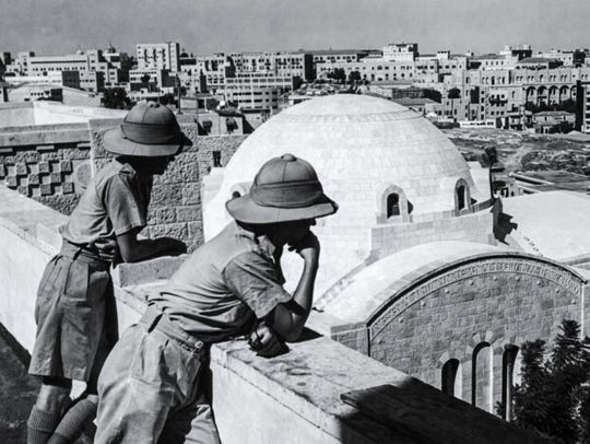 This photo taken in 1947 shows two British officers on the rooftop of the YMCA overlooking the modern city of Jerusalem.