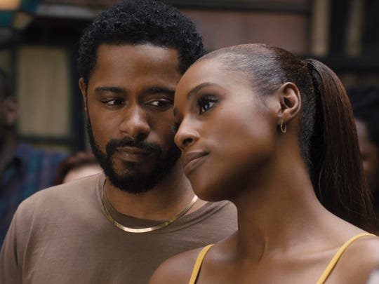 """LaKeith Stanfield, left, and Issa Rae in a scene from """"The Photograph."""""""