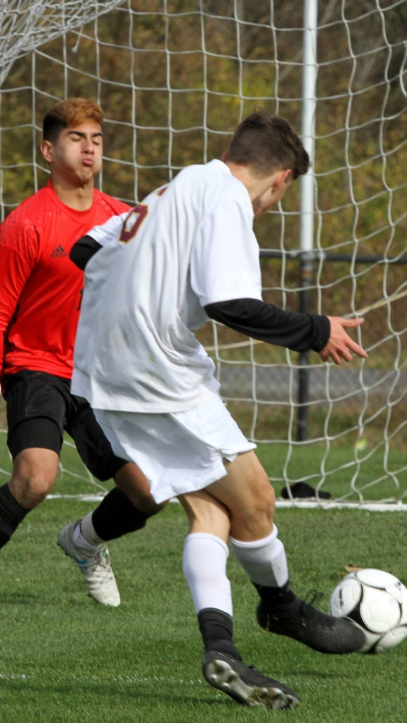 Ithaca's Andreas Lambrou  shoots and scores in the