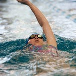 Pine Forest High School's Savannah Atchley competes in the girl's 100-yard backstroke during the District 1-3A championships at UWF Friday afternoon.
