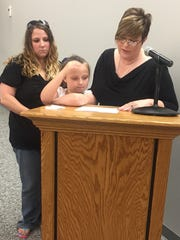 The family of Logan Evans -- Melanie Ball speaking as  Mikayla Ussery and Lauren Opdycke look on - thanked the Pickens County Council for naming a bridge Monday in his memory.