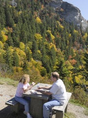 Parkway visitors enjoy a picnic lunch looking at Devils Courthouse on the Blue Ridge Parkway.