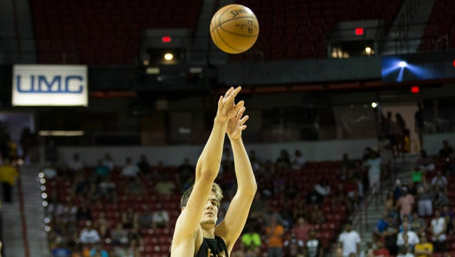 Phoenix Suns' Dragan Bender (35) shoots a free throw, which he missed, to send his team into overtime against the Denver Nuggets in the NBA Summer League quarterfinal game at the Thomas & Mack Center on Saturday, July 16, 2016, in Las Vegas.