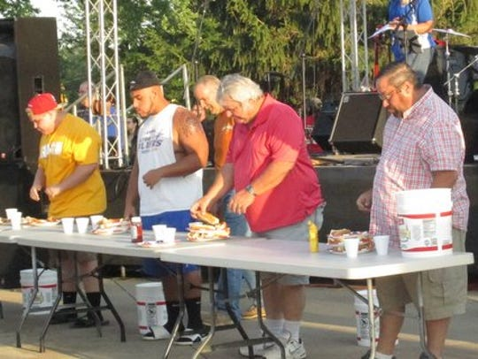 Competing in the Fourth of July hot dog eating contest
