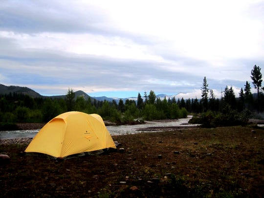 A tent sits on the banks of the South Fork of the Flathead River in the Bob Marshall Wilderness.