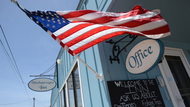 An American Flag whips in the wind at the Wachapreague Inn office on Thursday. A July Fourth parade in town has been rescheduled to Saturday, July 5, according to inn owner Nikki Wardius because of Tropical Storm Arthur.
